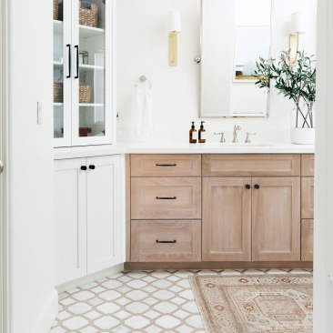 white hexagon tile basket weave pattern with oak cabinets master bathroom