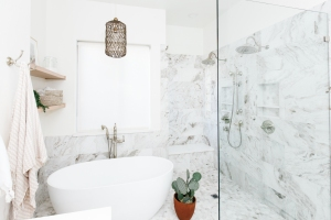 marble tile walk in shower and white modern soaker tub