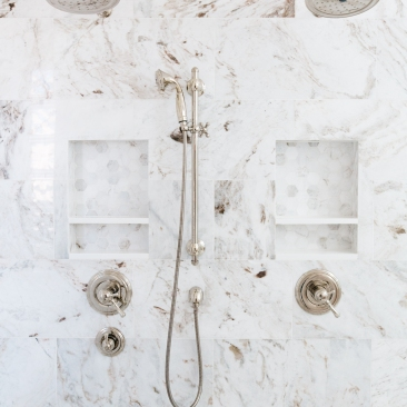 double polished nickle shower heads and trim with removable shower head and marble tile