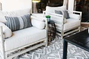 worn white modern outdoor chairs with black and white tribal print pillows black and white tribal print rug black outdoor coffee table