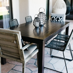dark stained modern wood table black accessories