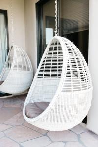 white wicker egg shaped mid century modern swings