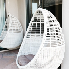 white wicker egg shaped mid century modern swings