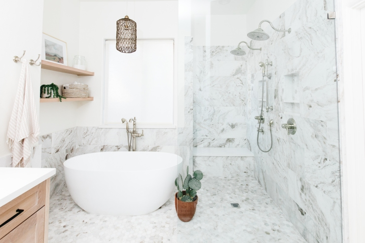 white and gray marble tiles two polished nickle rain shower heads modern soaker tub with handle