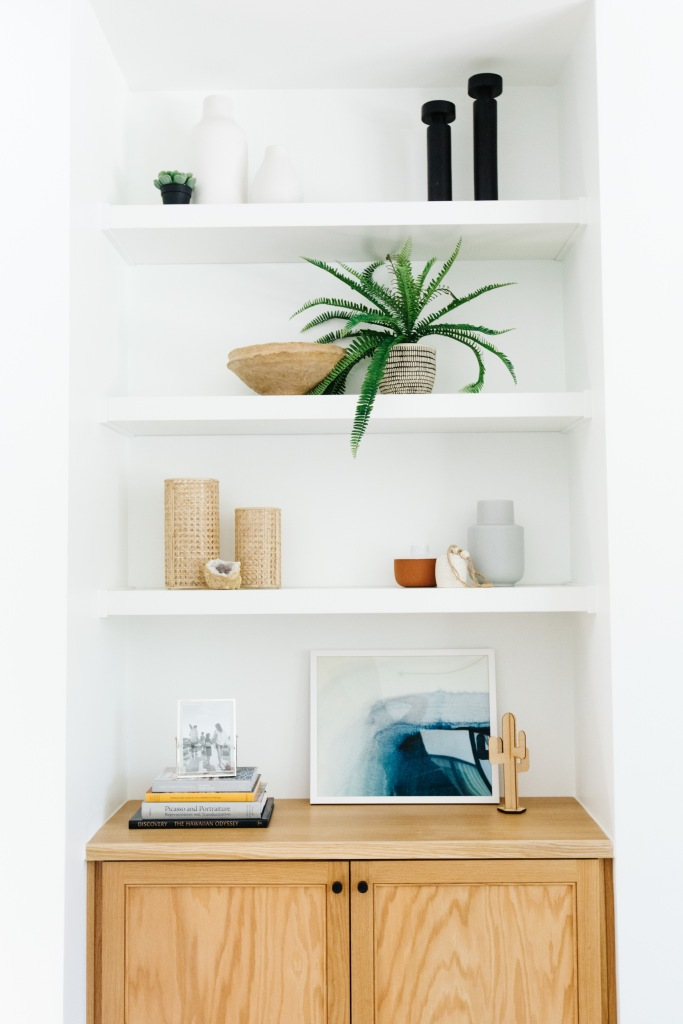 white shelves modern gold blue accents
