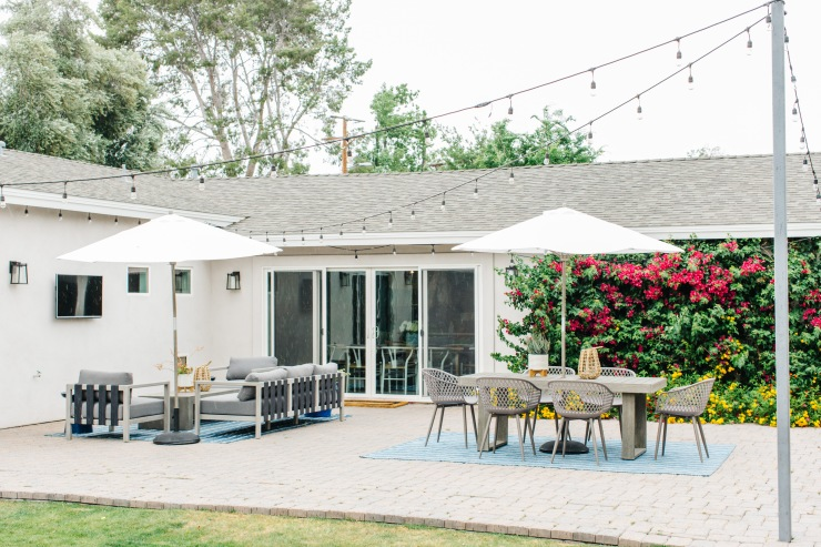 outdoor patio with tables chairs couch white umbrellas