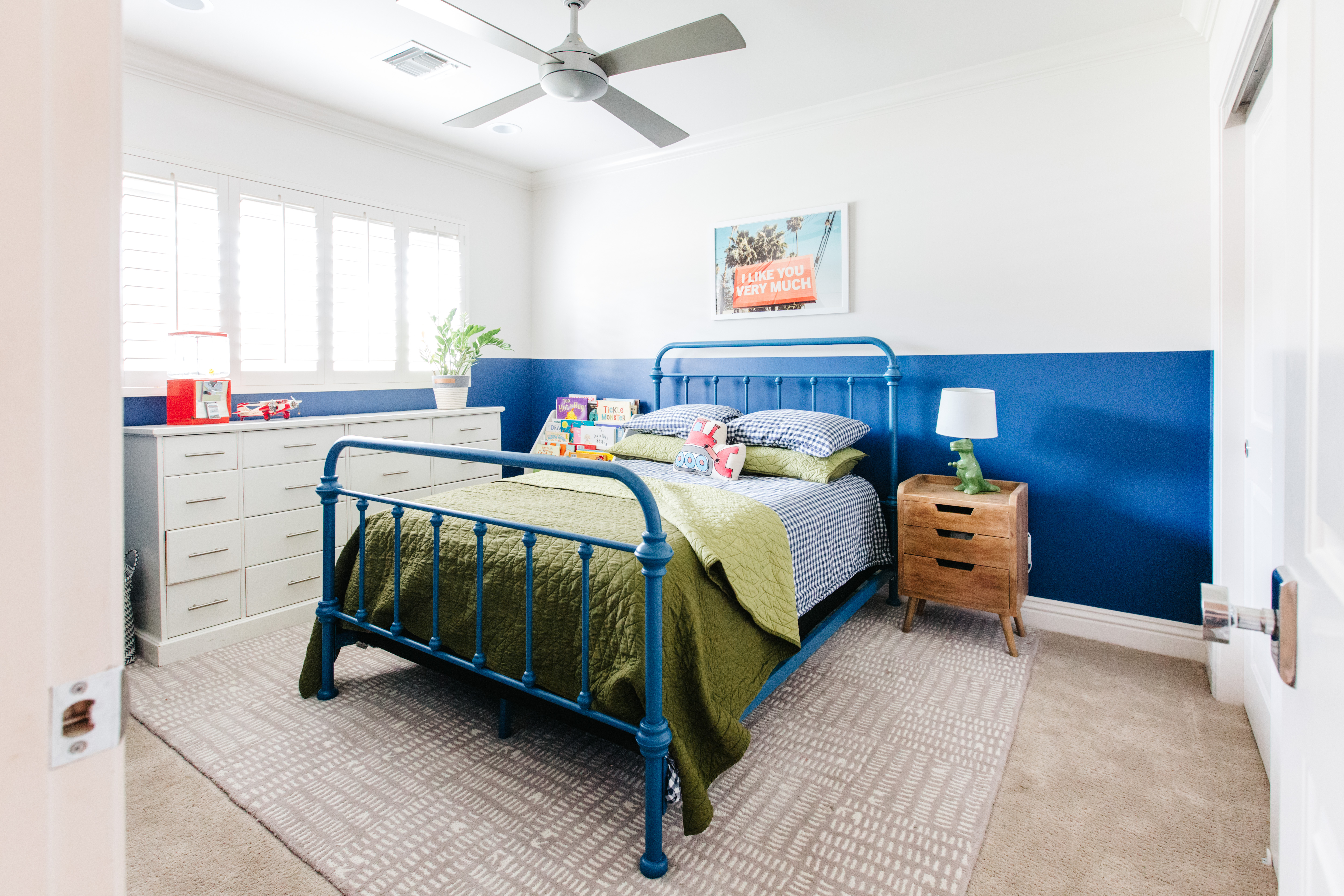 little boys bedroom navy blue wainscoting blue iron bed lime green bedding