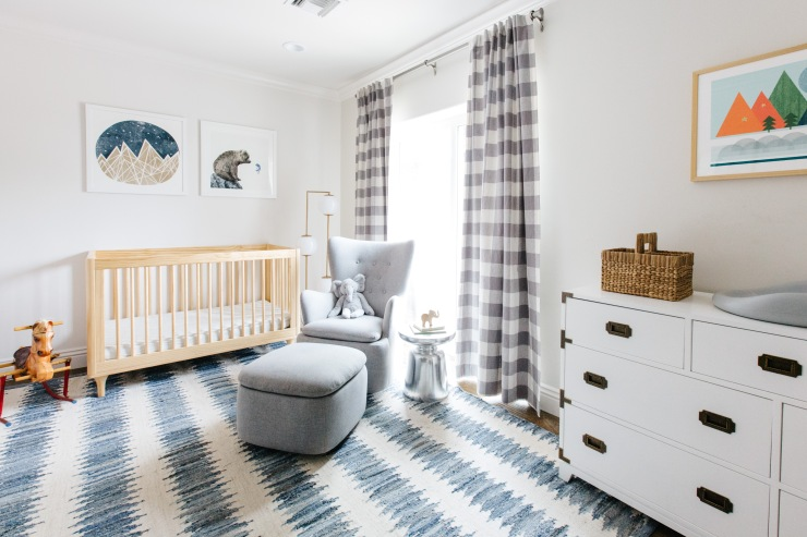 baby nursery with modern blue and white stripped rug gray gingham curtains gray furniture