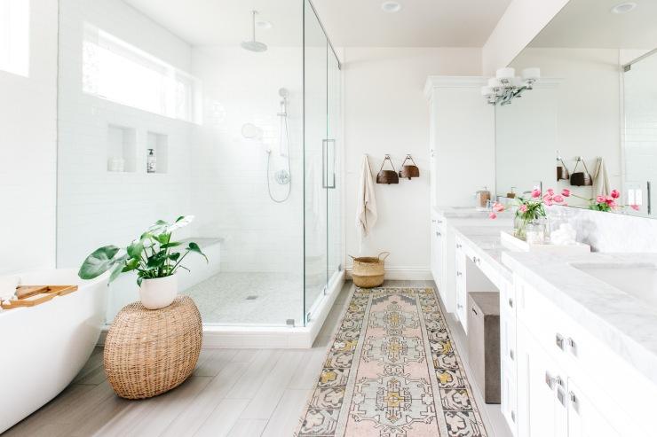 modern master bathroom with tribal pattern rug modern bathtub