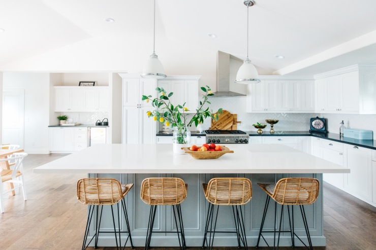 wicker barstools with a glue gray painted cabinets and white counter
