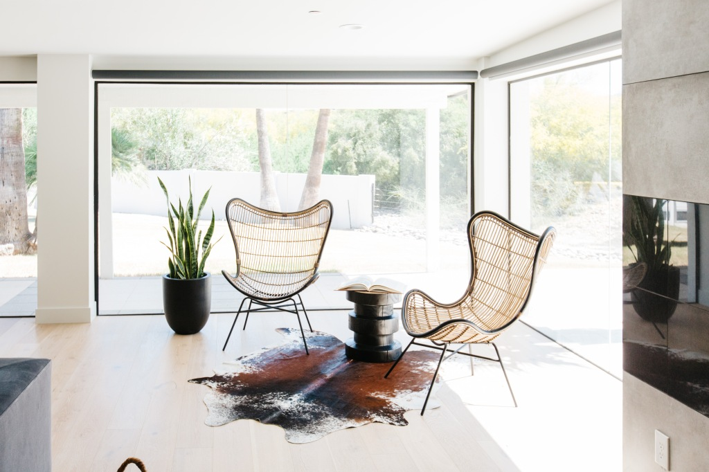 mid century modern wicker chairs with cowhide rug
