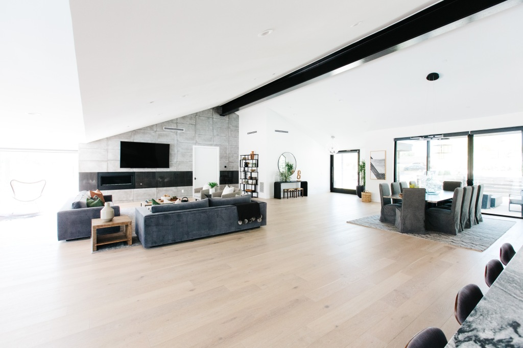 large modern great room with dark gray furniture
